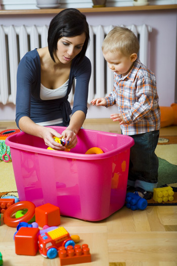 mother playing with son and tub of blocks